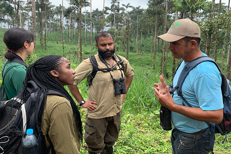 biologist Jorge Olivo explains ecology to students out in the field