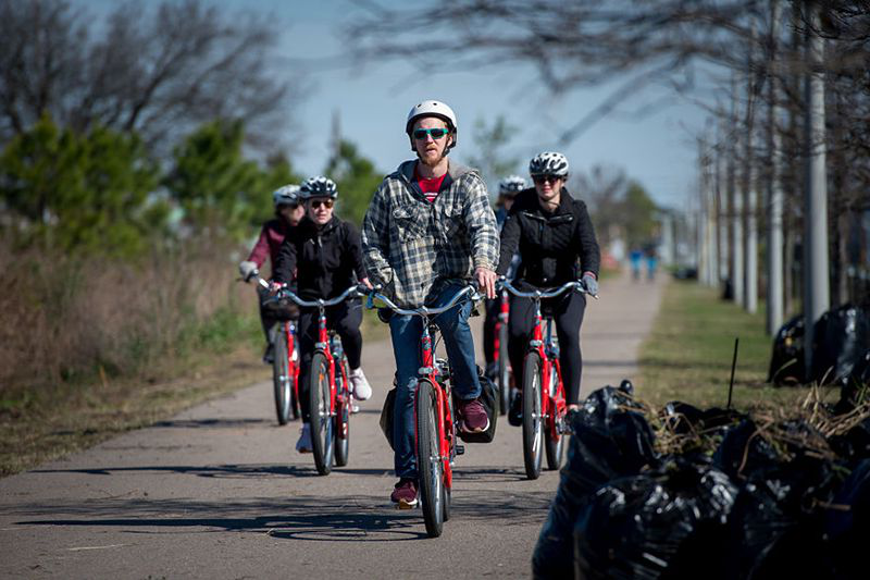 Bicyclists ride along the Lafitte Greenway